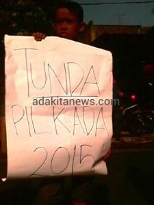PegaD, Tuntut KPU Tunda PILKADA 2015